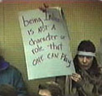 Charlene Teeters holding protest sign